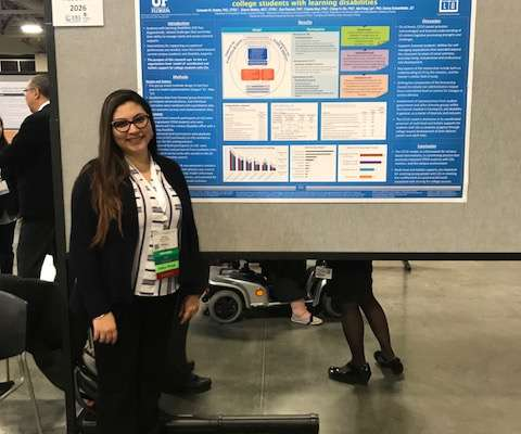 Sharon Medina posing with her research poster